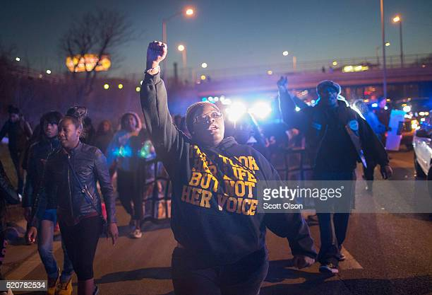 Demonstrators protesting the shooting death of 16yearold Pierre Loury block traffic on the Eisenhower Expressway during a march on April 12 2016 in...
