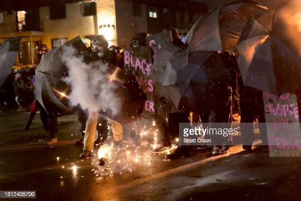 Demonstrators protesting the shooting death of Daunte Wright face off with police near the Brooklyn Center police station on April 13, 2021 in...