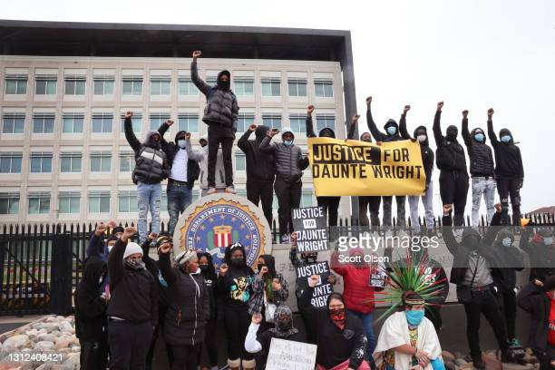 Demonstrators protesting the shooting death of Daunte Wright pause in front of the FBI offices during a march from the Brooklyn Center police station...
