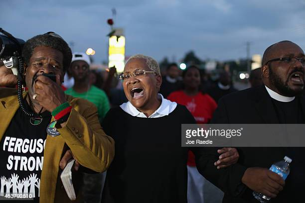 Demonstrators protesting the shooting death of Michael Brown make their voices heard on August 18, 2014 in Ferguson, Missouri. Protesters have been...