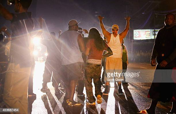 Demonstrators protesting the shooting death of Michael Williams confront police on August 15 2014 in Ferguson MissouriPolice shot pepper spray smoke...