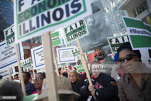 Demonstrators protesting the state of Illinois budget stalemate rally in the Loop before marching to the Chicago Board of Trade Building where they...
