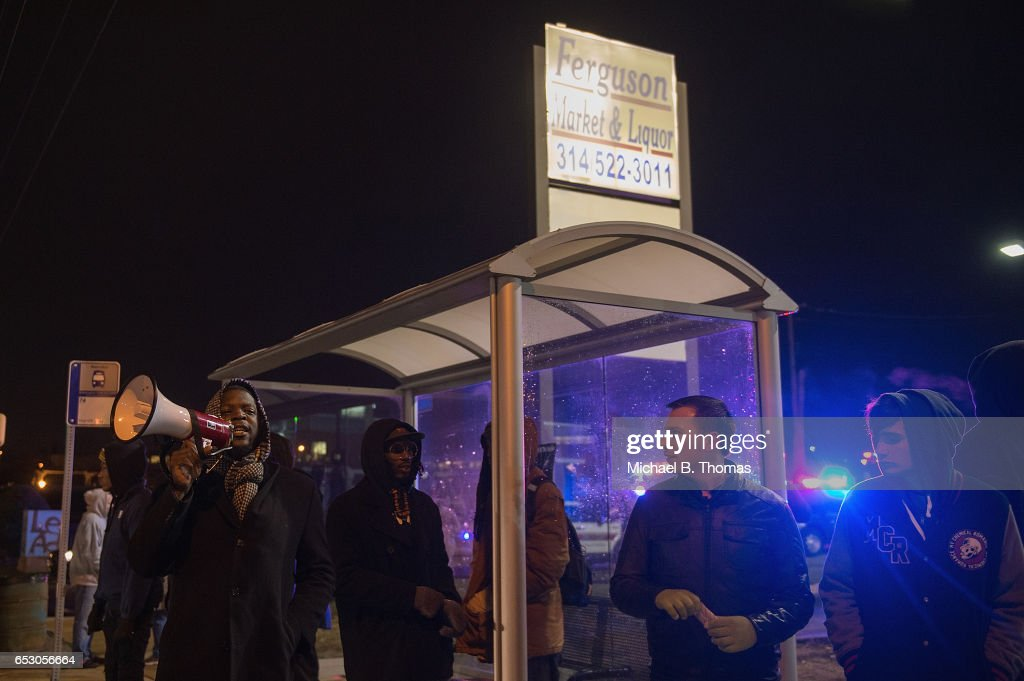 Demonstrators protests outside the Ferguson Market and Liquor on March 13, 2017 in Ferguson, Missouri. Tension and protest in Ferguson has arisen in response to video footage of slain 18 year-old Michael Brown in a recent documentary.