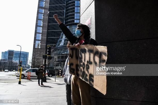 Demonstrators protests outside the Hennepin County Government Center on March 9, 2021 in Minneapolis, Minnesota. - Jury selection finally got...