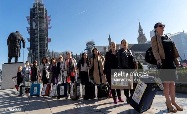 Demonstrators pull suitcases to symbolise the women who travel from Northern Ireland to Great Britain for a termination as they take part in a...