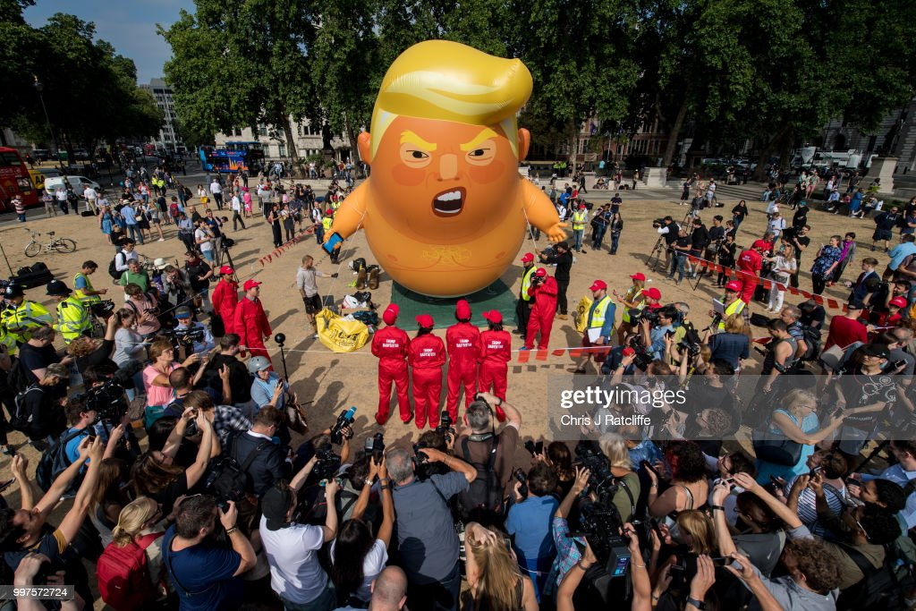 Demonstrators raise a six meter high effigy of Donald Trump, being dubbed the 'Trump Baby', in Parliament Square in protest against the U.S. President's current visit to the United Kingdom on July 13, 2018 in London, United Kingdom. The President of the United States and First Lady, Melania Trump, touched down yesterday in the UK on Air Force One for their first official visit. Today the President will visit Prime Minister Theresa May at Chequers and take tea with the Queen at Windsor Castle.