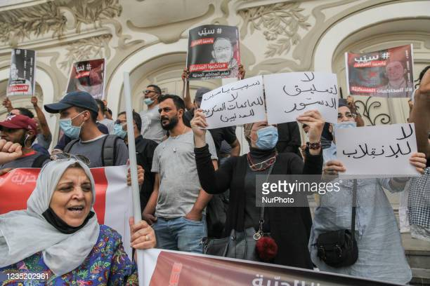 Demonstrators raise placards that read in Arabic release Yassine Ayari, no to the military trials of civilians, no to the coup, no to the suspension...