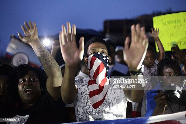 Demonstrators raise their hands as they protest the shooting death of 18yearold Michael Brown on August 15 2014 in Ferguson Missouri Michael Brown...