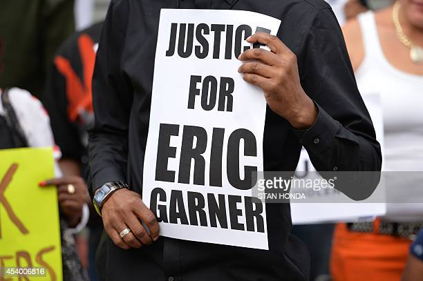 Demonstrators rally against police brutality in memory of Eric Garner on August 23 2014 in Staten Island New York The New York City medical...
