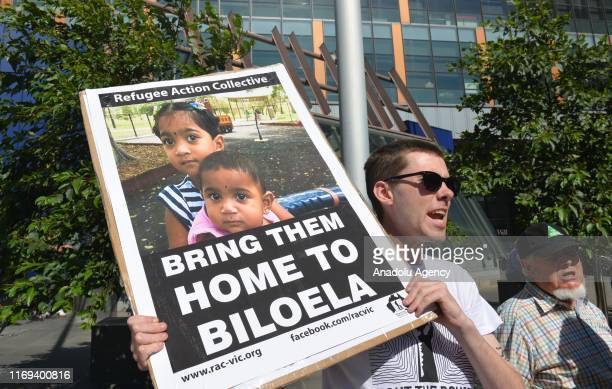 Demonstrators rally at the federal court in Melbourne in support of the Tamil family who were sent to Christmas Island to remain in detention last...