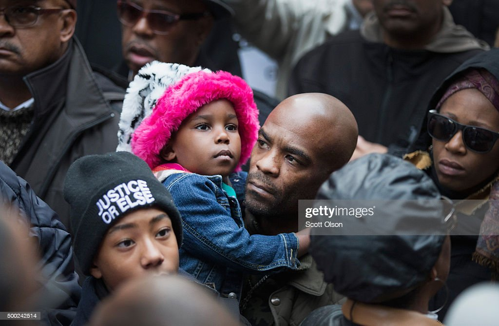 Demonstrators rally at the Thompson Center following a march through downtown to protest the death of Laquan McDonald and the alleged cover-up that followed on December 6, 2015 in Chicago, Illinois. Chicago Police officer Jason Van Dyke shot and killed 17-year-old McDonald on October 20, 2014, hitting him with 16 bullets. Van Dyke was charged with murder more than a year after the shooting after a judge ordered the release to the public of a video which showed McDonald backing away from Van Dyke while being shot.