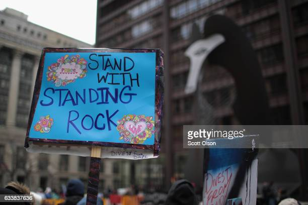 Demonstrators rally downtown before marching to Trump Tower while protesting the construction of the Dakota Access pipeline on February 4 2017 in...