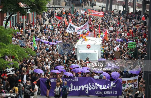 Demonstrators rally for a protest near the Elbphilharmonie concert hall on July 7 2017 in Hamburg northern Germany where leaders of the world's top...