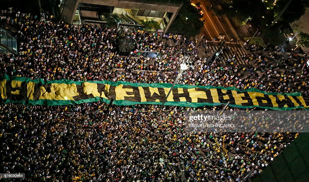 Demonstrators rally for Brazilian President Dilma Rousseff's impeachment along Paulista Avenue, in Sao Paulo, Brazil on March 16, 2016. Rousseff named her predecessor Luiz Inacio Lula da Silva as her chief of staff Wednesday, sparing him possible arrest for corruption as she seeks to fend off a damaging crisis. Ministerial immunity will now protect him from prosecution in ordinary court as cabinet ministers can only be tried before the Supreme Court in Brazil. AFP PHOTO / Miguel SCHINCARIOL / AFP / Miguel Schincariol