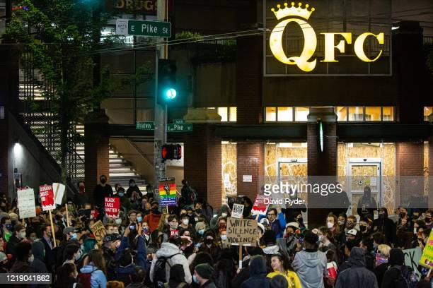 Demonstrators rally in a Capitol Hill neighborhood intersection after marching inside Seattle City Hall, led by Seattle City Council member Kshama...