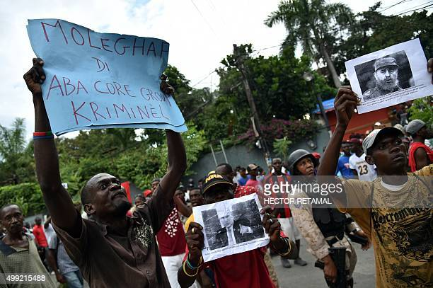 Demonstrators rally in front of the Provisional Electoral Council in the commune of Petion Ville PortauPrince on November 29 during a protest against...