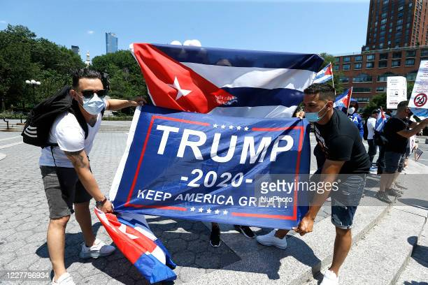 Demonstrators rally in Union Square against US economic and travel sanctions against Cuba in New York City on July 26 2020 Protesters against the...