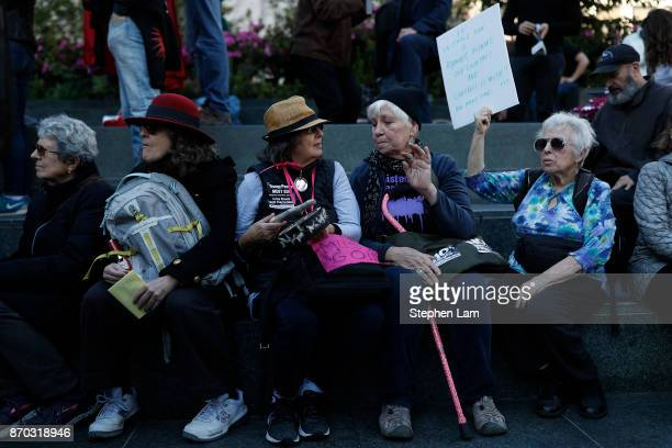 Demonstrators rally in Union Square during a nationwide protest against the Trump Administration on November 4, 2017 in San Francisco, California....