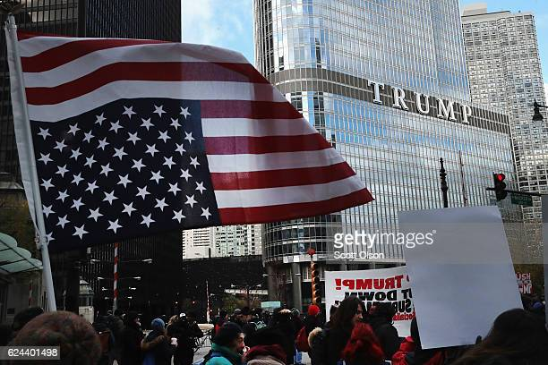 Demonstrators rally near Trump Tower after marching through downtown protesting PresidentElect Donald Trump on November 19 2016 in Chicago Illinois...