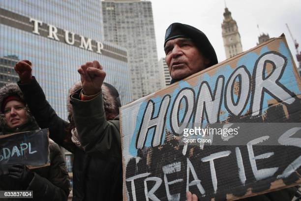 Demonstrators rally near Trump Tower while protesting the construction of the Dakota Access pipeline on February 4 2017 in Chicago Illinois President...