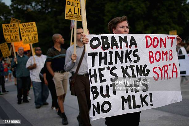 Demonstrators rally on the north side of the White House to protest any U.S. Military action against Syria August 29, 2013 in Washington, DC....