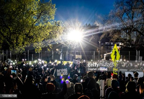 Demonstrators rally outside the Brooklyn Center police headquarters on April 16, 2021 in Brooklyn Center, Minnesota. This is the sixth day of...