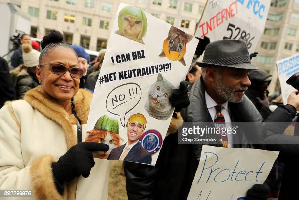 Demonstrators rally outside the Federal Communication Commission building to protest against the end of net neutrality rules December 14 2017 in...