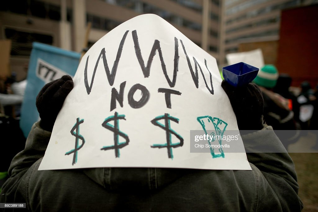 Demonstrators rally outside the Federal Communication Commission building to protest against the end of net neutralityrules December 14, 2017 in Washington, DC. Lead by FCC Chairman Ajit Pai, the commission is expected to do away with Obama Administration rules that prevented internet service providers from creating different levels of service and blocking or promoting individual companies and organizations on their systems.