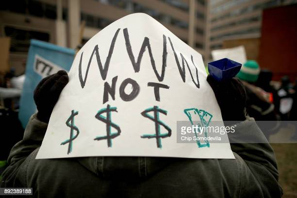Demonstrators rally outside the Federal Communication Commission building to protest against the end of net neutralityrules December 14 2017 in...