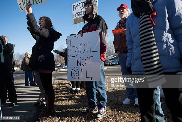 Demonstrators rally outside the Iowa Ag Summit at the Iowa State Fairgrounds in Des Moines Iowa US on Saturday March 7 2015 The event aims to...