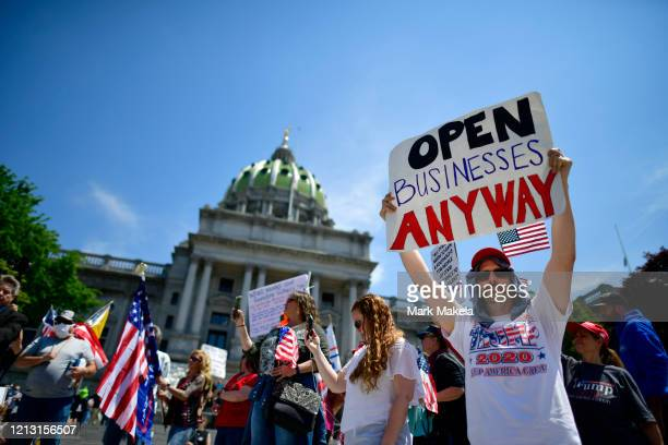Demonstrators rally outside the Pennsylvania Capitol Building regarding the continued closure of businesses due to the coronavirus pandemic on May...