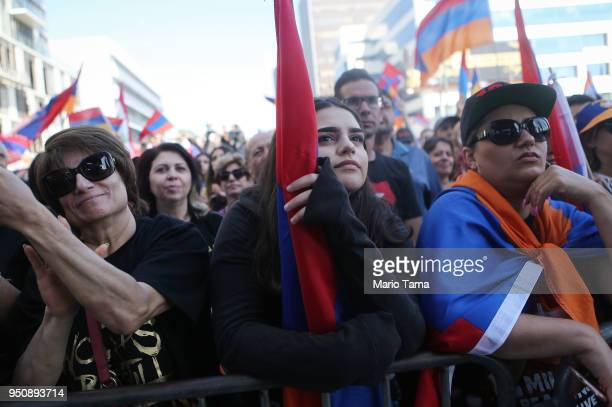 Demonstrators rally outside the Turkish Consulate during a march and rally commemorating the 103rd anniversary of the Armenian genocide on April 24...