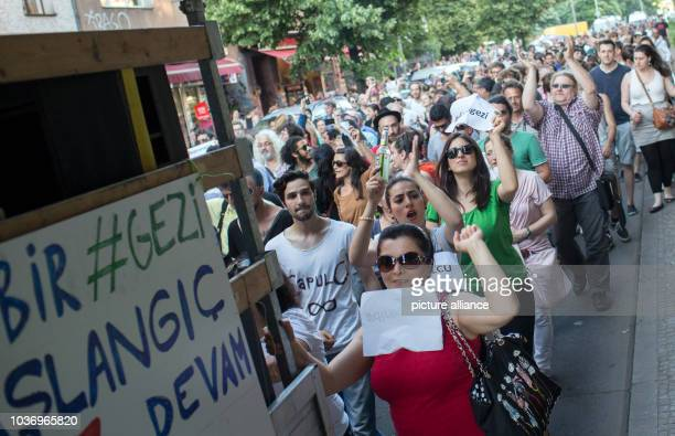 Demonstrators rally through the streets during the Fête de la Musique event in the Kreuzberg district of Berlin Germany 21 June 2013 Several hundred...