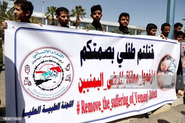 Demonstrators rally to demand the reopening of the Sana'a airport and resumption of flights, outside the Sana'a international airport on March 21,...
