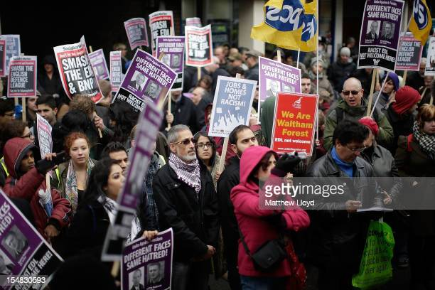 Demonstrators rally to protest against the farright English Defence League in Walthamstow on October 27 2012 in London England The EDL had wished to...