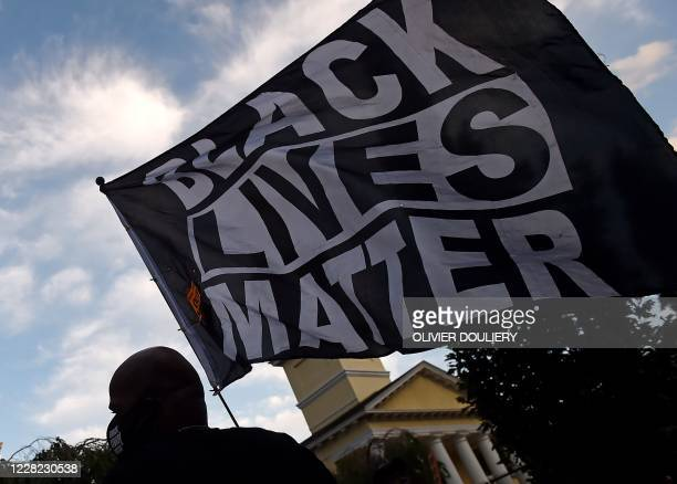 Demonstrators rally to protest US President Donald Trump's acceptance of the Republican National Convention nomination at Black Lives Matter plaza...