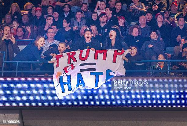 Demonstrators react after learning a rally for Republican presidential candidate Donald Trump at the University of Illinois at Chicago would be...