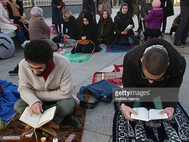 Demonstrators read holy Quran as they gather at Breitscheidplatz square to protest against the Chapel Hill shooting in Berlin Germany on February 15...