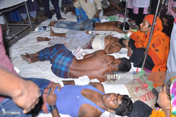 Demonstrators receive medical treatment in a hospital after police fired on people protesting over a Facebook post by a Hindu who allegedly defamed...