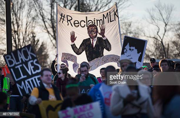 Demonstrators remember Michael Brown with a Martin Luther King Jr Day march from the apartment complex where he was killed to the Ferguson police...