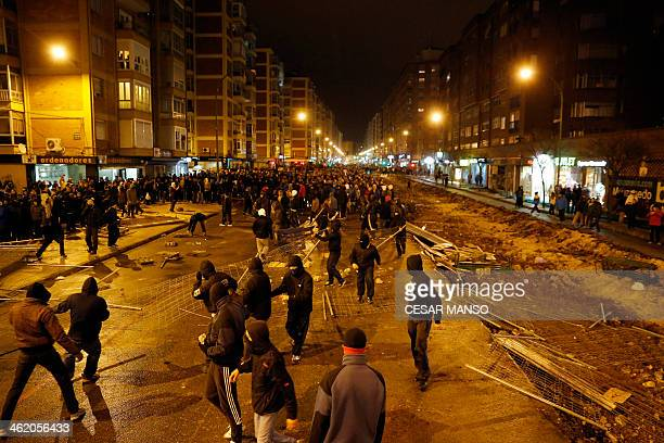 Demonstrators remove fencing during a protest against imminent construction works to revamp Vitoria street the city's main thoroughfare in Burgos on...