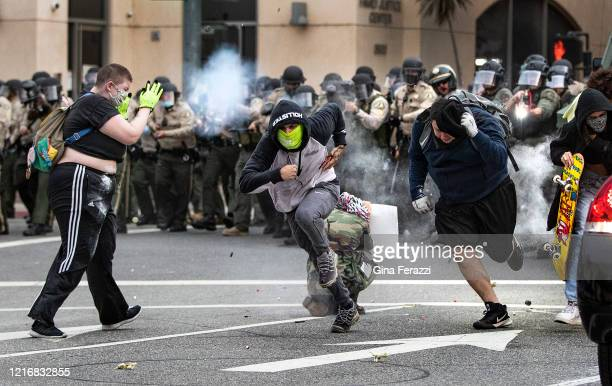 Demonstrators retreat as Riverside County Sheriffs fire nonlethal rounds after law enforcement announced an unlawful assembly and protesters did not...