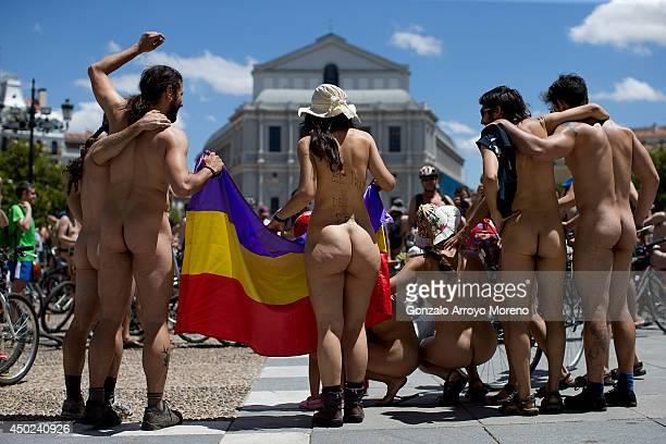 Demonstrators ride their bikes naked during a Naked Cycle demonstration on June 7 2014 in Madrid Spain Nude cyclists are protesting cars and the lack...