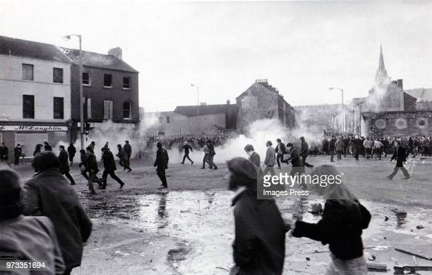 Demonstrators run after tear gas explosions on 'Bloody Sunday' circa 1972 in Northern Ireland