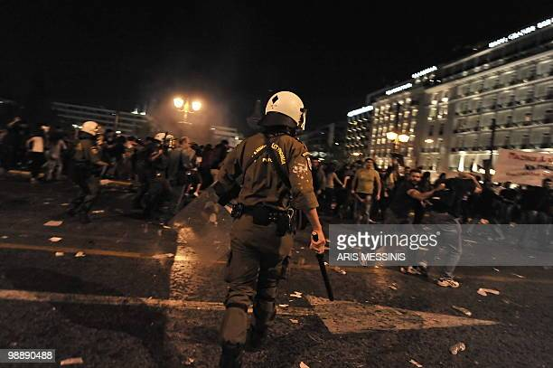 Demonstrators run away from riot police during a protest in front of the Greek Parliament on May 6 2010 More than 10000 people demonstrated...