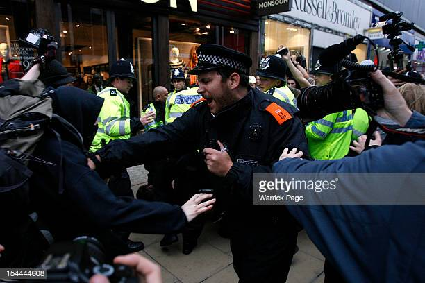 Demonstrators scuffle with police during a protest against the government's austerity measures on October 20 2012 in London England Thousands of TUC...