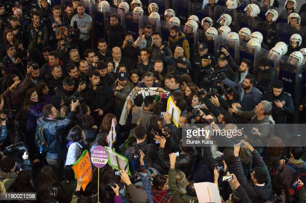 Demonstrators scuffle with riot police during a protest against femicide and violence against women on November 25 2019 in Istanbul Turkey November...