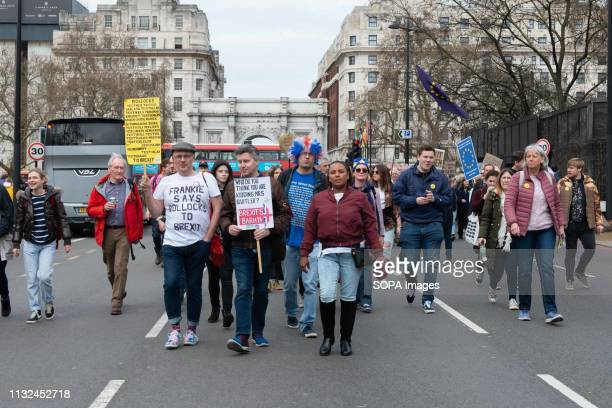 Demonstrators see walking in the street with placards during the protest Over one million protesters gathered at the People's Rally in London...