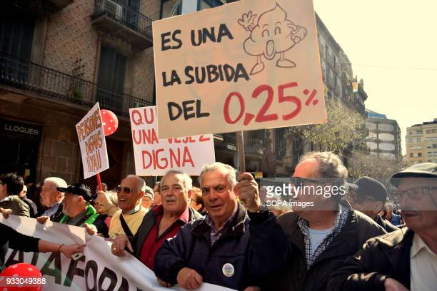 Demonstrators seen displaying placards and banner during the protest Ten of thousands of pensioners took to the street of Barcelona during a protest...