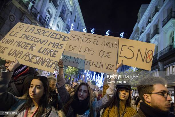 Demonstrators seen displaying placards and shouting slogans during the march Thousands marched in Madrid for the International Day for the...